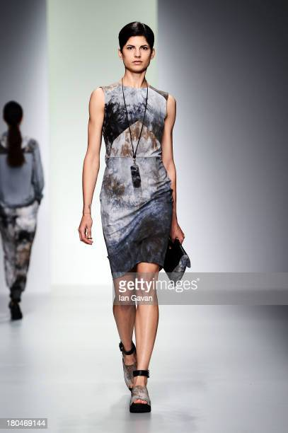 A model walks the runway at the Christopher Raeburn show during London Fashion Week SS14 at BFC Courtyard Showspace on September 13 2013 in London...