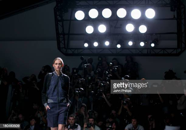 Model walks the runway at the Christopher Raeburn show during London Fashion Week SS14 at BFC Courtyard Showspace on September 13, 2013 in London,...