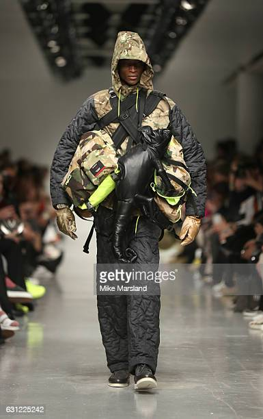Model walks the runway at the Christopher Raeburn show during London Fashion Week Men's January 2017 collections at BFC Show Space on January 8, 2017...