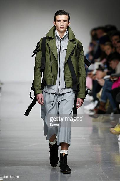 A model walks the runway at the Christopher Raeburn show during London Fashion Week Men's January 2017 collections at BFC Show Space on January 8...