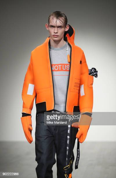 Model walks the runway at the Christopher Raeburn show during London Fashion Week Men's January 2018 at BFC Show Space on January 7, 2018 in London,...