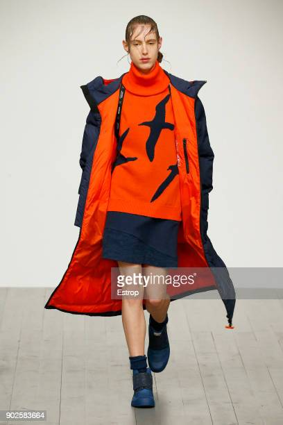 A model walks the runway at the Christopher Raeburn show during London Fashion Week Men's January 2018 at BFC Show Space on January 7 2018 in London...