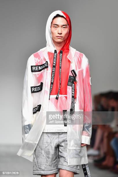 A model walks the runway at the Christopher Raeburn show during London Fashion Week Men's June 2018 BFC Show Space on June 10 2018 in London England