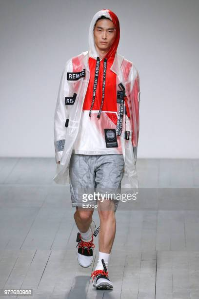 A model walks the runway at the Christopher Raeburn show during London Fashion Week Men's June 2018 at the BFC Show Space on June 10 2018 in London...