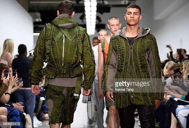 Model walks the runway at the Christopher Raeburn show during the London Collections: Men SS15 on June 15, 2014 in London, England.