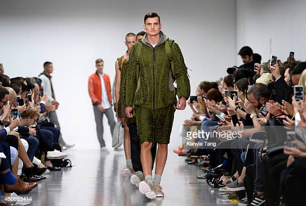 A model walks the runway at the Christopher Raeburn show during the London Collections Men SS15 on June 15 2014 in London England