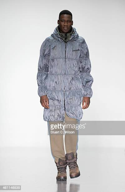 Model walks the runway at the Christopher Raeburn show during The London Collections: Men Autumn/Winter 2014 on January 7, 2014 in London, England.