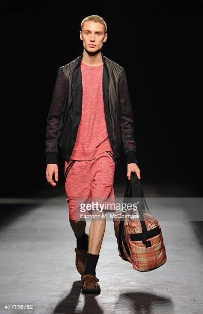 Model walks the runway at the Christopher Raeburn show during The London Collections Men SS16 at The Old Sorting Office on June 14, 2015 in London,...