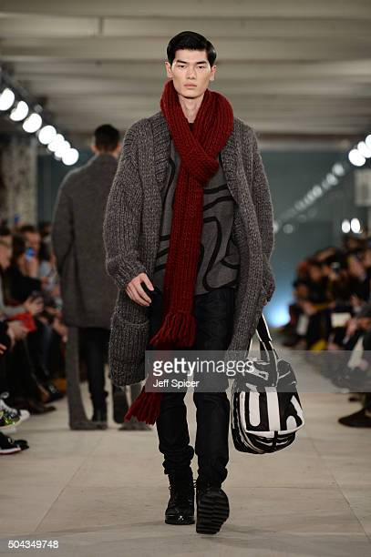 A model walks the runway at the Christopher Raeburn show during The London Collections Men AW16 at 180 The Strand on January 10 2016 in London England