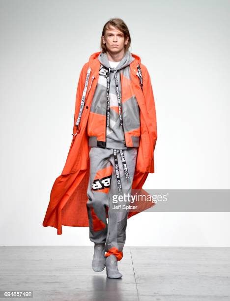 A model walks the runway at the Christopher Raeburn show during the London Fashion Week Men's June 2017 collections on June 11 2017 in London England