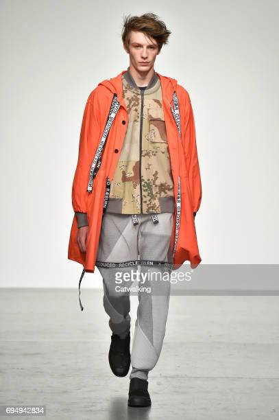 A model walks the runway at the Christopher Raeburn Show Spring Summer 2018 fashion show during London Menswear Fashion Week on June 11 2017 in...