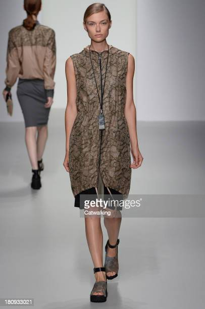 Model walks the runway at the Christopher Raeburn Spring Summer 2014 fashion show during London Fashion Week on September 13, 2013 in London, United...