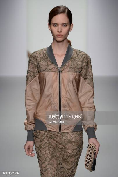 A model walks the runway at the Christopher Raeburn Spring Summer 2014 fashion show during London Fashion Week on September 13 2013 in London United...