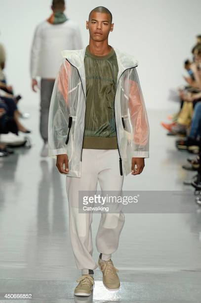 A model walks the runway at the Christopher Raeburn Spring Summer 2015 fashion show during London Menswear Fashion Week on June 15 2014 in London...
