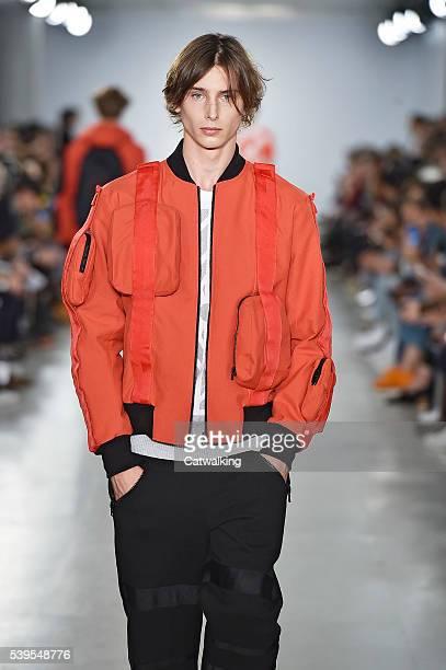 Model walks the runway at the Christopher Raeburn Spring Summer 2017 fashion show during London Menswear Fashion Week on June 12, 2016 in London,...