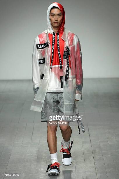 A model walks the runway at the Christopher Raeburn Spring/Summer 2019 fashion show during London Fashion Week Men's June 2018 on June 10 2018 in...