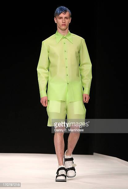 A model walks the runway at the Christopher Shannon show during the London Collections MEN SS14 at The Old Sorting Office on June 18 2013 in London...
