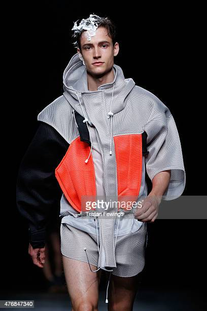 Model walks the runway at the Christopher Shannon show during The London Collections Men SS16 at The Old Sorting Office on June 12, 2015 in London,...