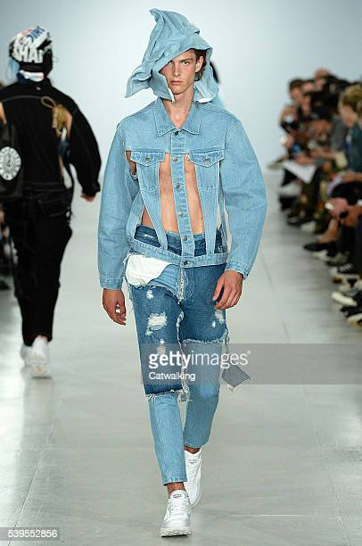A model walks the runway at the Christopher Shannon Spring Summer 2017 fashion show during London Menswear Fashion Week on June 12 2016 in London...