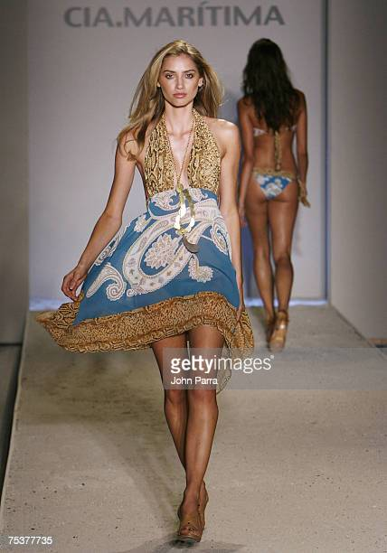 """Model walks the runway at the Cia Maritima swimwear fashion show in the Oasis tent during """"Mercedes Benz Fashion Week: Miami Swim"""" at the Raleigh..."""