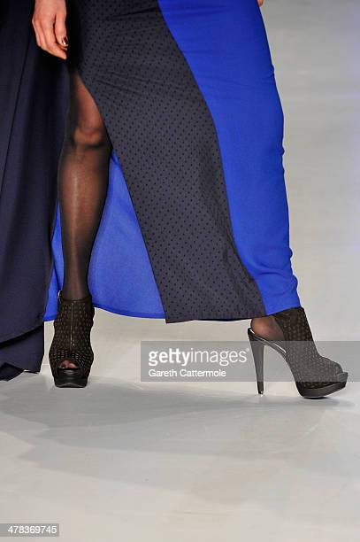A model walks the runway at the Cigdem Akin show during MBFWI presented by American Express Fall/Winter 2014 on March 13 2014 in Istanbul Turkey