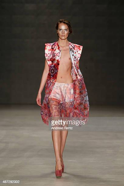 A model walks the runway at the Cigdem Akin show during Mercedes Benz Fashion Week Istanbul SS15 at Antrepo 3 on October 16 2014 in Istanbul Turkey