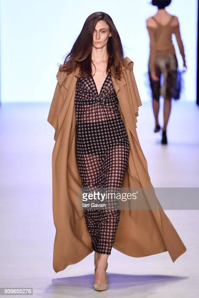 A model walks the runway at the Cigdem Akin show during Mercedes Benz Fashion Week Istanbul at Zorlu Performance Hall on March 29 2018 in Istanbul...