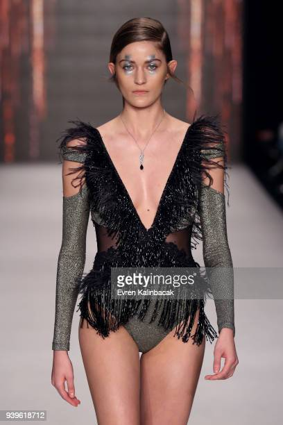 A model walks the runway at the Cihan Nacar show during Mercedes Benz Fashion Week Istanbul at Zorlu Performance Hall on March 29 2018 in Istanbul...
