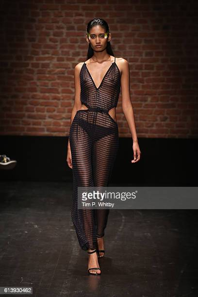 A model walks the runway at the Cihan Nacar show during MercedesBenz Fashion Week Istanbul at Zorlu Center on October 11 2016 in Istanbul Turkey