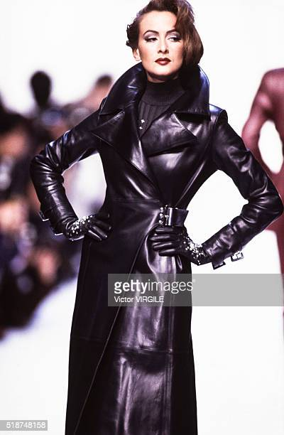 A model walks the runway at the Claude Montana Ready to Wear Fall/Winter 19921993 fashion show during the Paris Fashion Week in March 1992 in Paris...