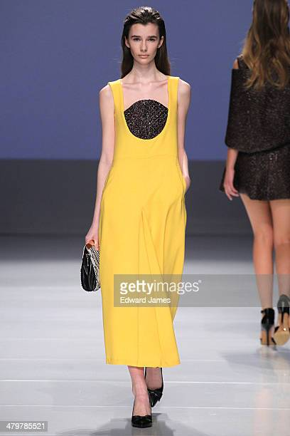 A model walks the runway at the Claudette by Claudette fashion show during World Mastercard fashion week on March 20 2014 in Toronto Canada