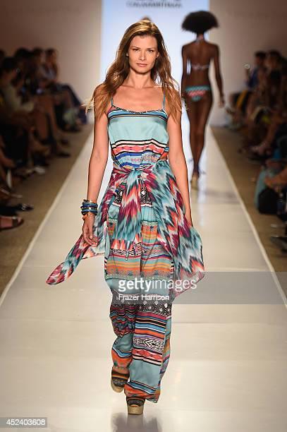 A model walks the runway at the CM CiaMaritima Swimwear fashion show during MercedesBenz Fashion Week Swim 2015 at Cabana Grande at The Raleigh on...