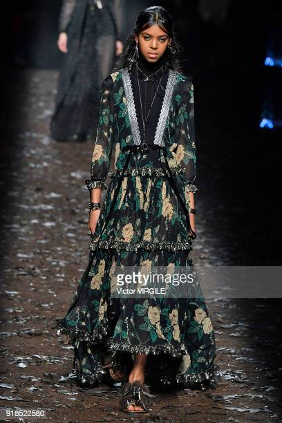 Model walks the runway at the Coach 1941 Ready to Wear Fall/Winter 2018-2019 Fashion show during New York Fashion Week on February 13, 2018 in New...