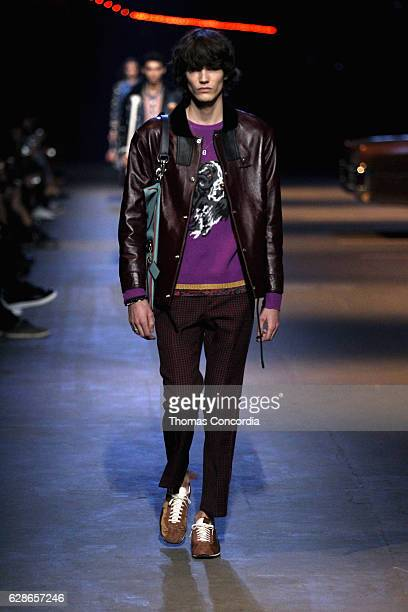 A model walks the runway at the Coach 75th Anniversary Women's PreFall and Men's Fall Show Runway on December 8 2016 in New York City
