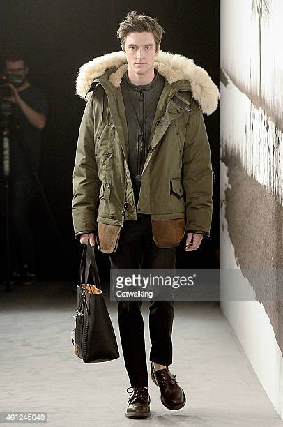 A model walks the runway at the Coach Autumn Winter 2015 fashion show during London Menswear Fashion Week on January 9 2015 in London United Kingdom