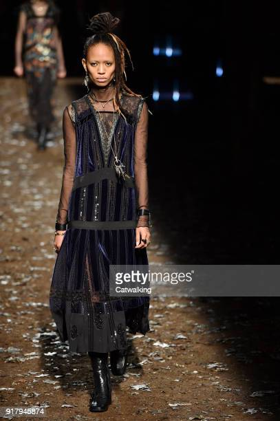 Model walks the runway at the Coach Autumn Winter 2018 fashion show during New York Fashion Week on February 13, 2018 in New York, United States.
