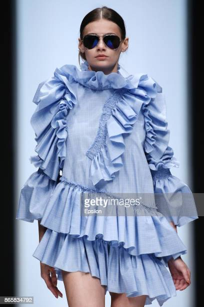A model walks the runway at the Collective show supported by the State Program of the President of the Republic of Kazakhstan 'Spiritual Renovation'...