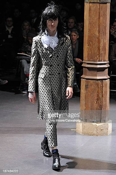 A model walks the runway at the Comme Des Garcons Autumn Winter 2012 fashion show during Paris Menswear Fashion Week on January 20 2012 in Paris...