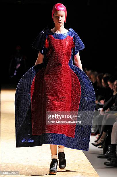 A model walks the runway at the Comme des Garcons Autumn Winter 2012 fashion show during Paris Fashion Week on March 3 2012 in Paris France