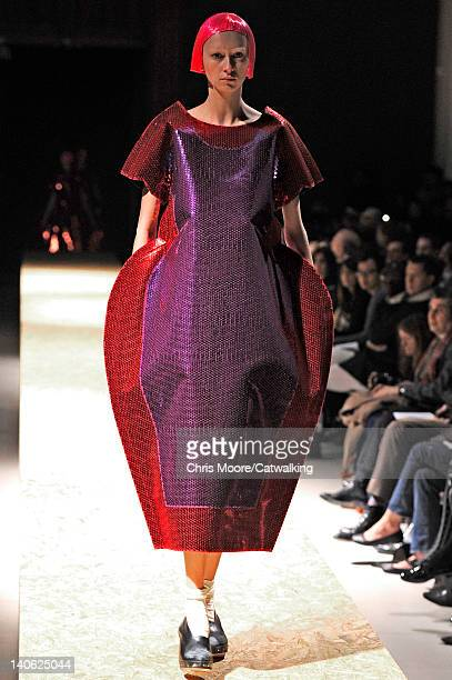 Model walks the runway at the Comme des Garcons Autumn Winter 2012 fashion show during Paris Fashion Week on March 3, 2012 in Paris, France.