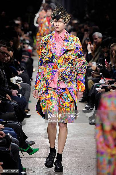 A model walks the runway at the Comme des Garcons Autumn Winter 2013 fashion show during Paris Fashion Week on March 2 2013 in Paris France