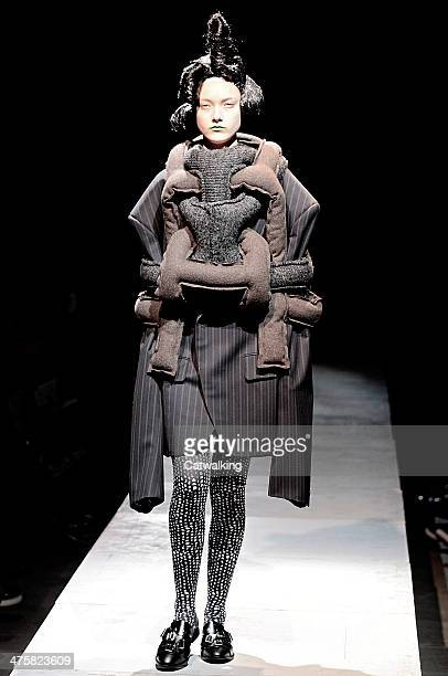 Model walks the runway at the Comme Des Garcons Autumn Winter 2014 fashion show during Paris Fashion Week on March 1, 2014 in Paris, France.