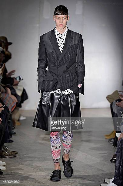 A model walks the runway at the Comme Des Garcons Autumn Winter 2015 fashion show during Paris Menswear Fashion Week on January 23 2015 in Paris...