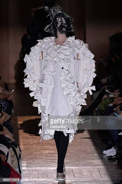 A model walks the runway at the Comme Des Garcons Autumn Winter 2015 fashion show during Paris Fashion Week on March 7 2015 in Paris France