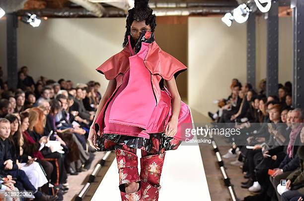 A model walks the runway at the Comme Des Garcons Autumn Winter 2016 fashion show during Paris Fashion Week on March 5 2016 in Paris France