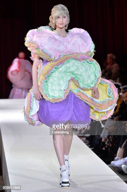 A model walks the runway at the Comme Des Garcons Autumn Winter 2018 fashion show during Paris Fashion Week on March 3 2018 in Paris France
