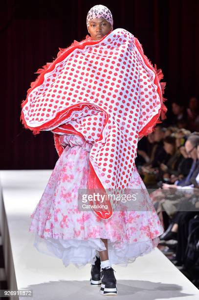 Model walks the runway at the Comme Des Garcons Autumn Winter 2018 fashion show during Paris Fashion Week on March 3, 2018 in Paris, France.