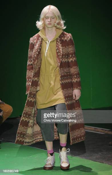 A model walks the runway at the Comme Des Garcons Homme Plus Autumn Winter 2013 fashion show during Paris Menswear Fashion Week on January 18 2013 in...