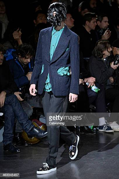 A model walks the runway at the Comme Des Garcons Homme Plus Autumn Winter 2014 fashion show during Paris Menswear Fashion Week on January 17 2014 in...