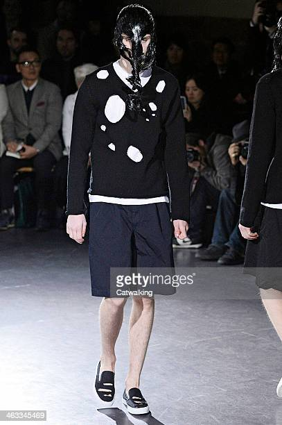Model walks the runway at the Comme Des Garcons Homme Plus Autumn Winter 2014 fashion show during Paris Menswear Fashion Week on January 17, 2014 in...